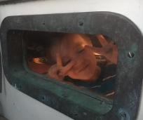 Cody thru his bunk porthole
