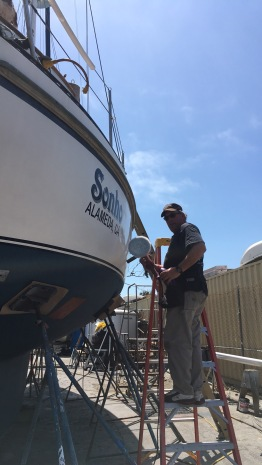Aaron buffing the hull as we wait for the bottom paint to dry between coats.