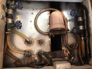 Water tank mechanisms. Foot pump filter is in upper right.